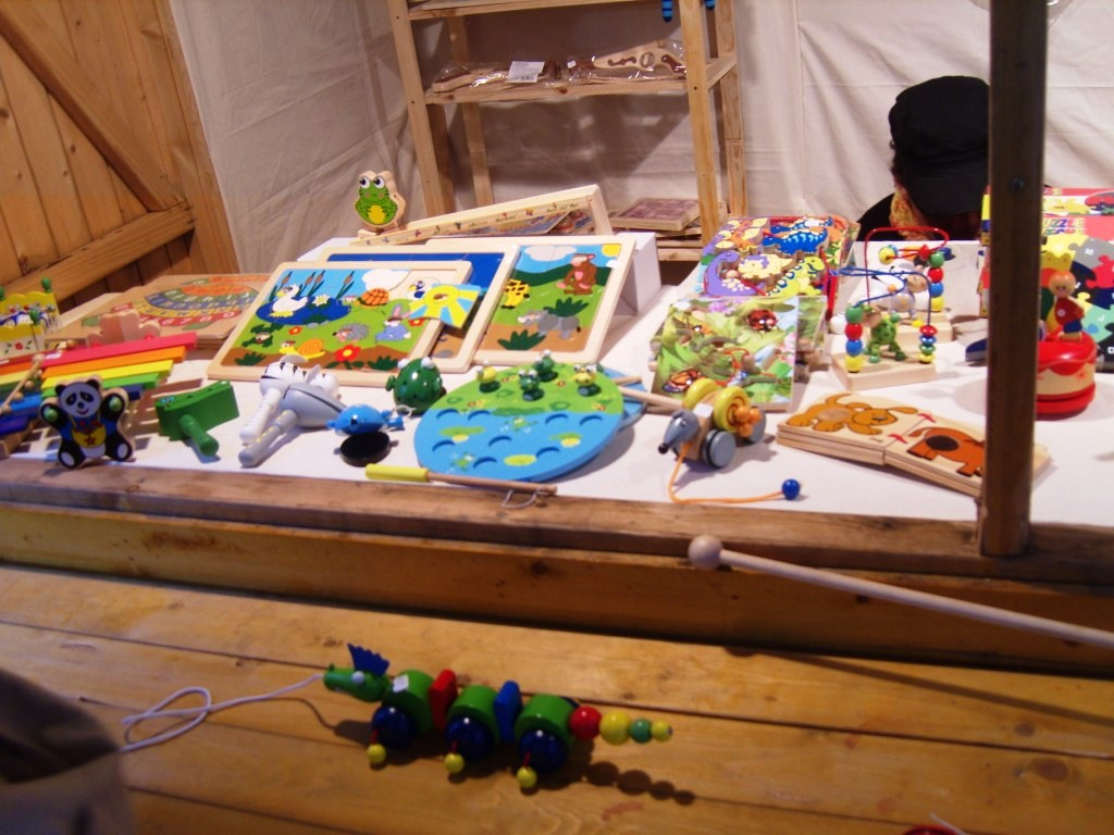 """Handmade wooden toys in Christmas Market in Montmartrre Paris"""
