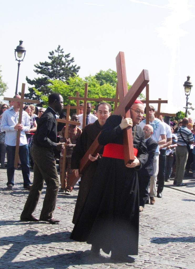 """Archbishop of Paris Cardinal Vingt-Trois carrying cross on Good Friday in Montmartre"""