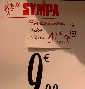 """Sympa price sign showing 75% less of original boutique prices in Paris"""